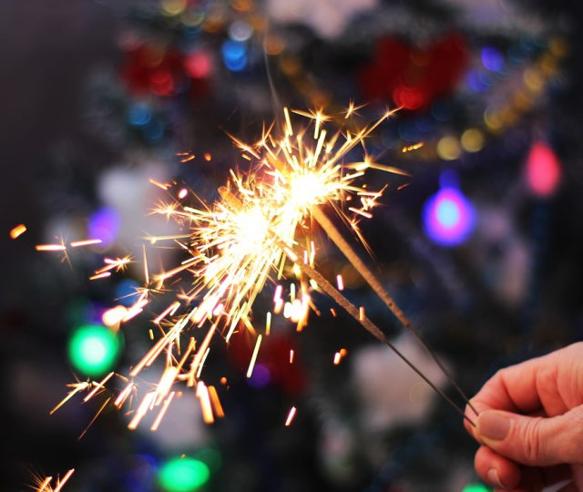female-hand-holding-burning-sparklers2